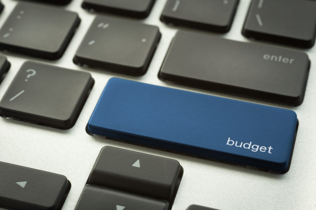 Laptop keyboard with typographic BUDGET button